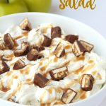 Snickers Caramel Apple Salad - a creamy, dreamy salad made with Snickers candy bars, pudding and whipped topping!