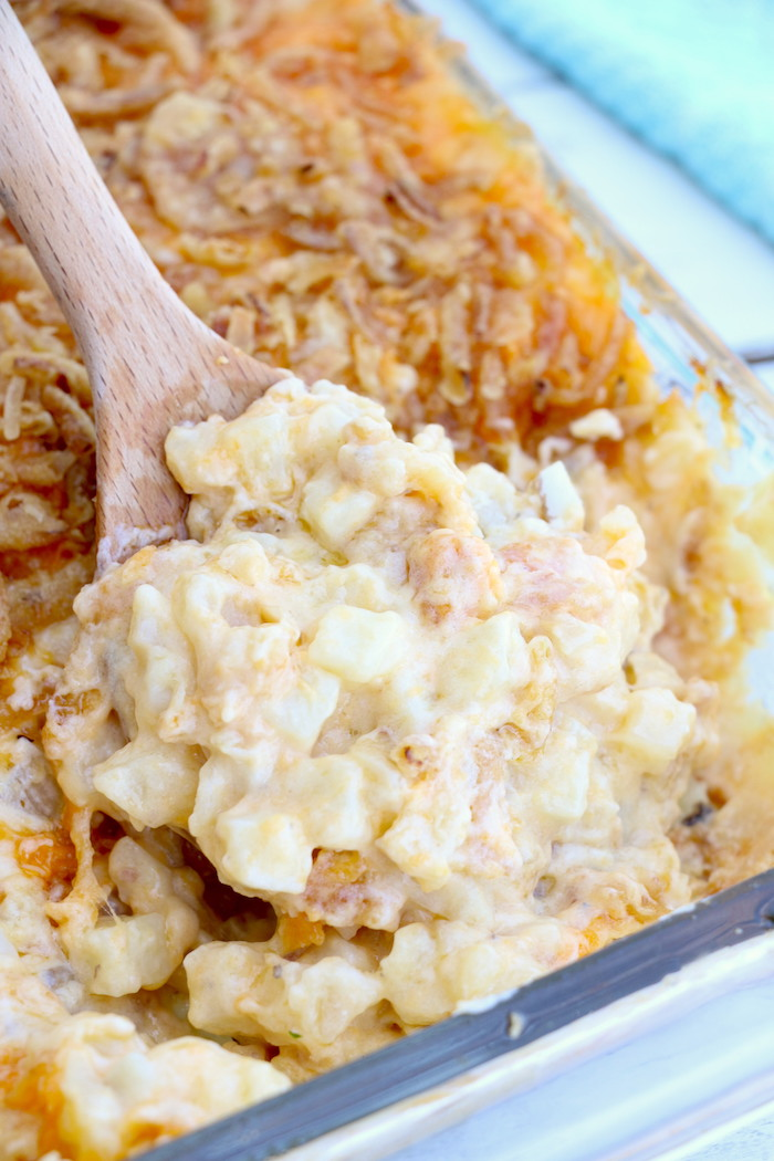 Cheesy Hashbrown Potatoes - Cheesy potato casserole topped with crunchy French fried onions! One of the best hash brown casserole recipes out there!