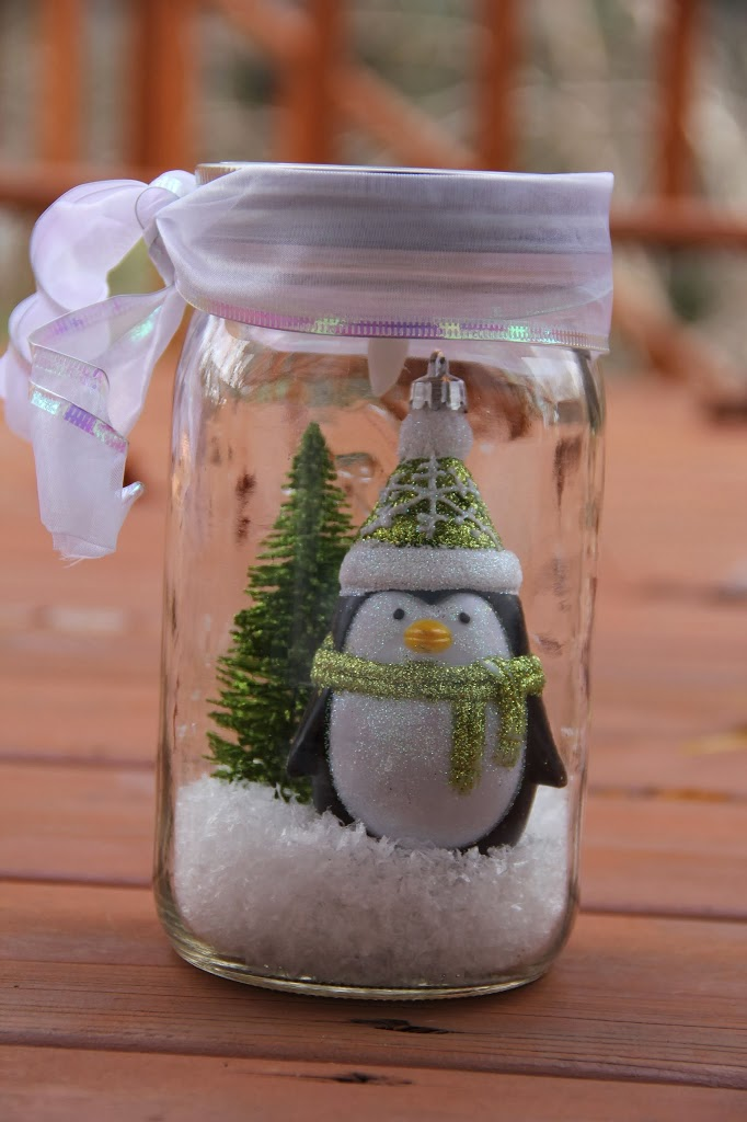 Illuminated Snow Scene in a Jar - An LED tea light illuminates a decorative winter scene inside of a mason jar. Such an easy and beautiful decoration for winter and Christmas!