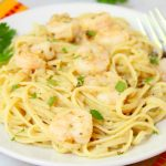 Shrimp Scampi - Flavorful shrimp covered with breadcrumbs, broiled and tossed with buttery linguine!