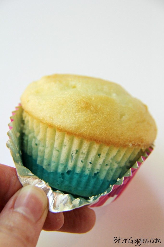 Cotton Candy Frosting on top of blue ombre cupcakes, garnished with more cotton candy, could it get any better?!