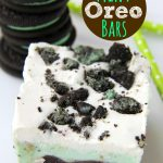 Chocolate Fudge Mint Oreo Bars - Mint chocolate chip ice cream bar dessert with a crunchy Oreo crust and fudge swirled throughout!