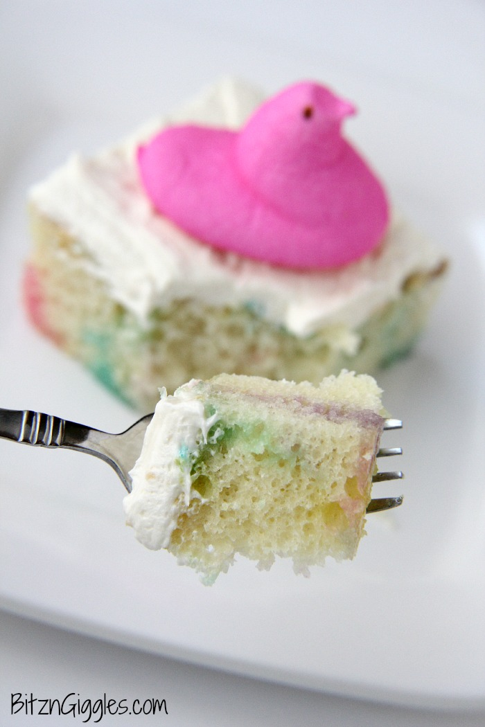 Peeps Cake With Marshmallow Frosting - This cake incorporates bits of Peeps right into the baking process, producing a colorful and slightly sweetened cake with a fluffy, marshmallow frosting that literally melts in your mouth!