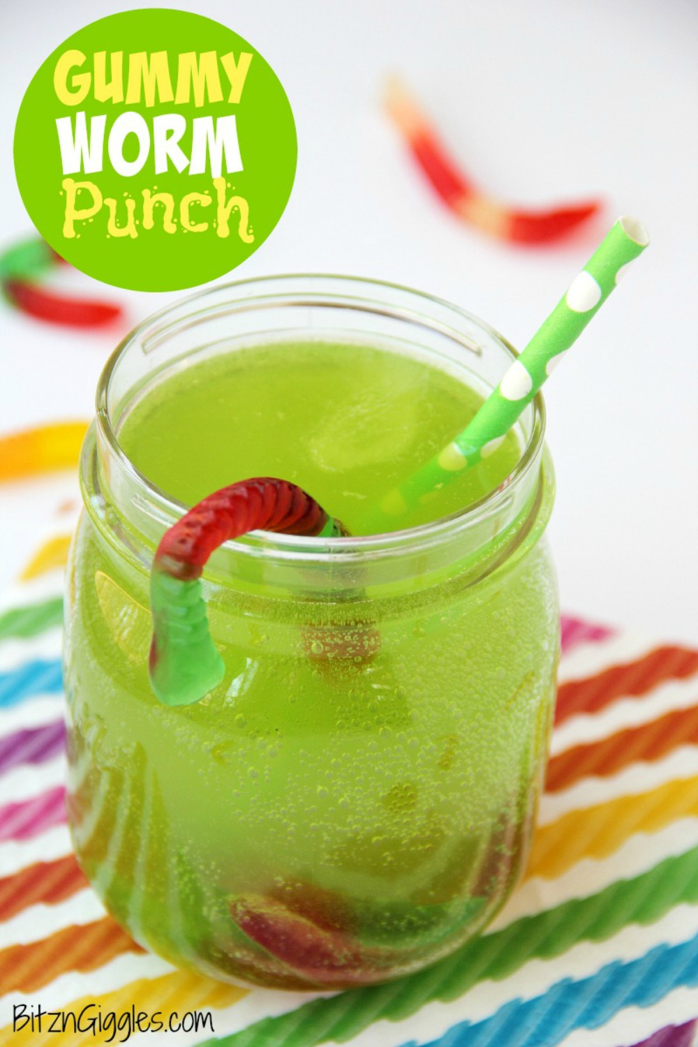 Gummy Worm Punch - Gummy worms are frozen in a punch mixture and emerge from the ice as the drink is enjoyed! So much fun and perfect for birthday parties and Halloween!