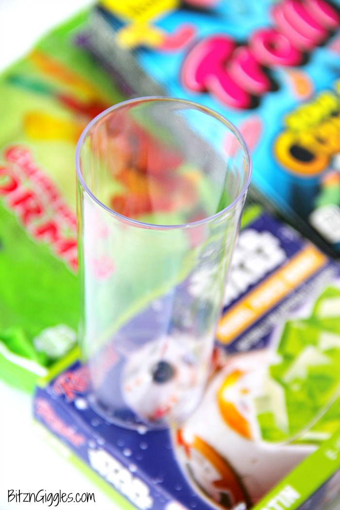 "Gummy Worm Jello Shooters - A fun kids treat perfect for mad scientist parties and Halloween! Gummy worms are suspended in green jello and the treat is garnished with a full size worm ""crawling"" out of the glass!"