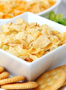 Chicken Salad Dip - This easy dip is a twist on a classic hot chicken salad recipe that I've had in my recipe box for some time now. It's a cheesy and creamy chicken mixture topped with crushed potato chips and perfect for cracker or tortilla chip dipping!