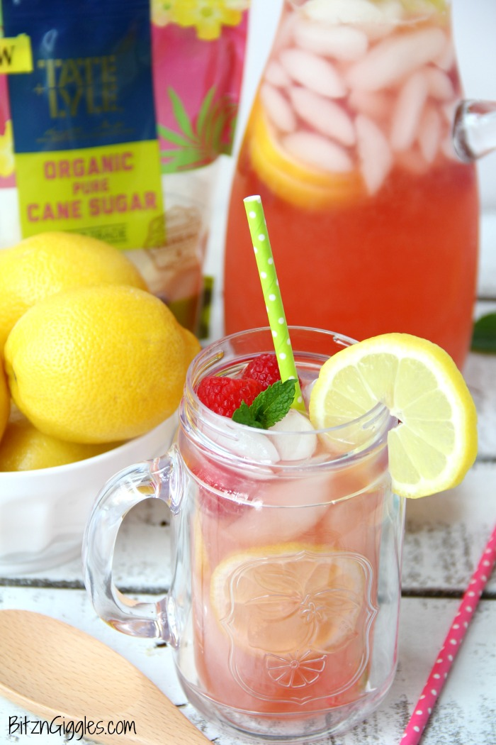 Pink Lemonade - Homemade pink lemonade made with fresh raspberries and lemons! So easy and so refreshing and delicious for a baby shower, summer party or picnic!