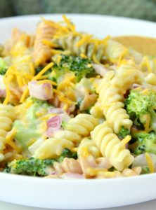 Broccoli Cheddar Pasta Salad - Broccoli, red onion, shredded cheese and rotini pasta tossed in a sweet, creamy dressing! Everyone always asks for seconds!