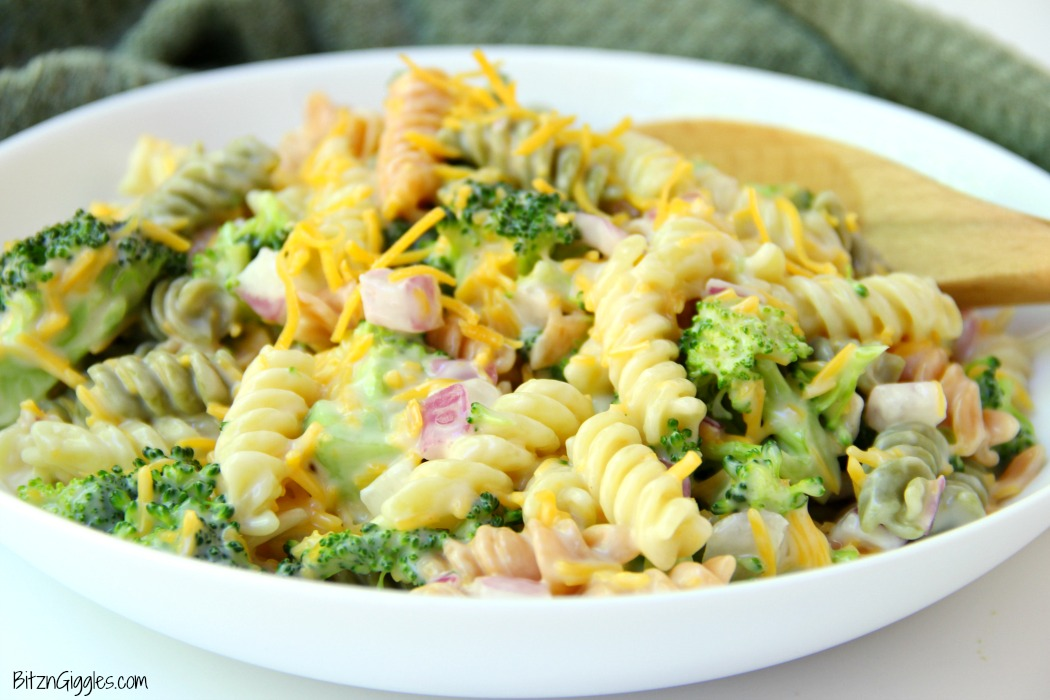 Cheddar Broccoli Pasta Salad - Broccoli, red onion, shredded cheese and rotini pasta tossed in a sweet, creamy dressing! Everyone always asks for seconds!