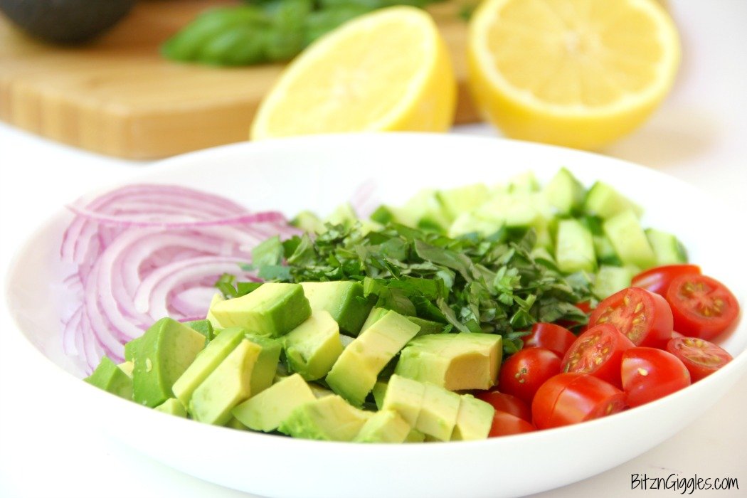 Avocado Salad - A healthy and colorful salad featuring avocado, tomato, cucumber, basil and a splash of lemon!