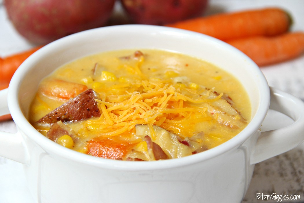 Potato Corn Chowder - Just like Grandma used to make! This flavorful combination of potatoes, corn, carrots and bacon in a creamy, cheesy broth is perfect for the whole family!
