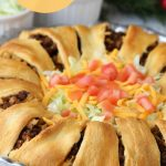 Ultimate Crescent Roll Taco Ring - This isn't just a taco ring, it's filled with guacamole, sour cream, cheese and tomatoes - easy and delicious, ready to serve a crowd!