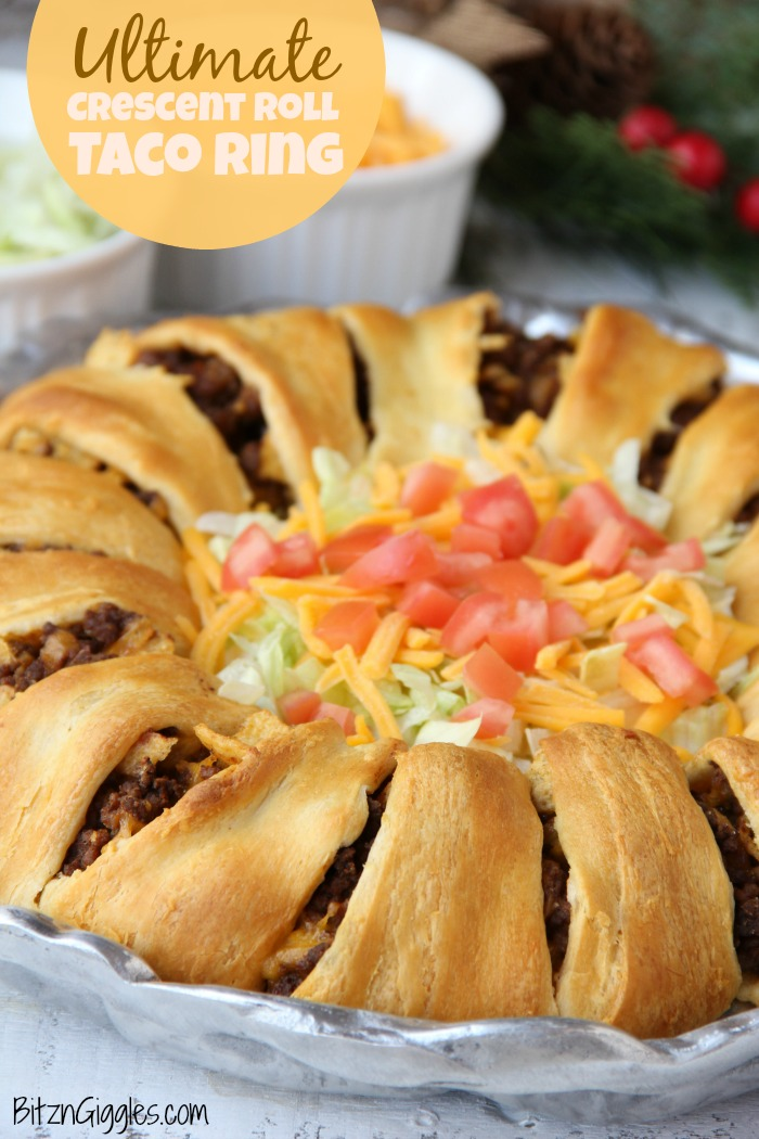 Ultimate Crescent Roll Taco Ring - This isn't just any old taco ring, it's filled with corn chips, guacamole, sour cream, cheese and tomatoes - easy and delicious, ready to serve a crowd!