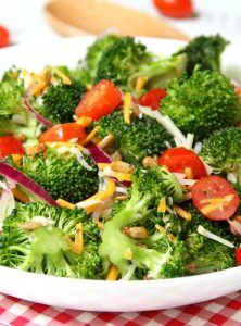 Broccoli and Tomato Salad - Sweet grape tomatoes, red onion, broccoli, cheese and sunflower seeds drizzled with a tangy raspberry vinaigrette.
