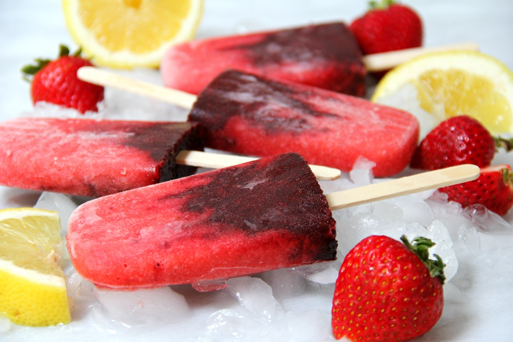 Very Berry Popsicles - Fresh strawberries swirled with blackberries and lemon make these homemade popsicles a truly refreshing treat!