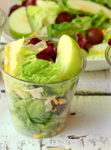 Harvest Salad to Go - A delicious combination of granny smith apples, grapes, cheese, bacon bits and more make this a perfect addition to any party menu! Serve in cups for easy and convenient eating!
