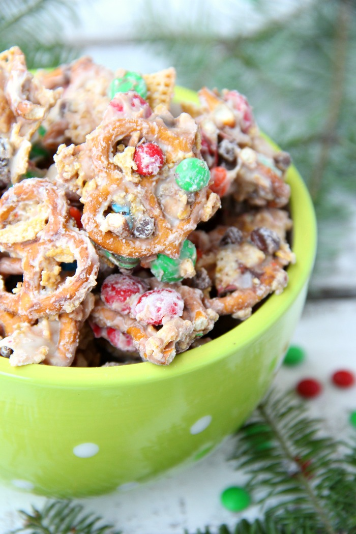 Christmas Crunch Snack Mix - An addicting combination of sweet and salty deliciousness enveloped in decadent white chocolate!
