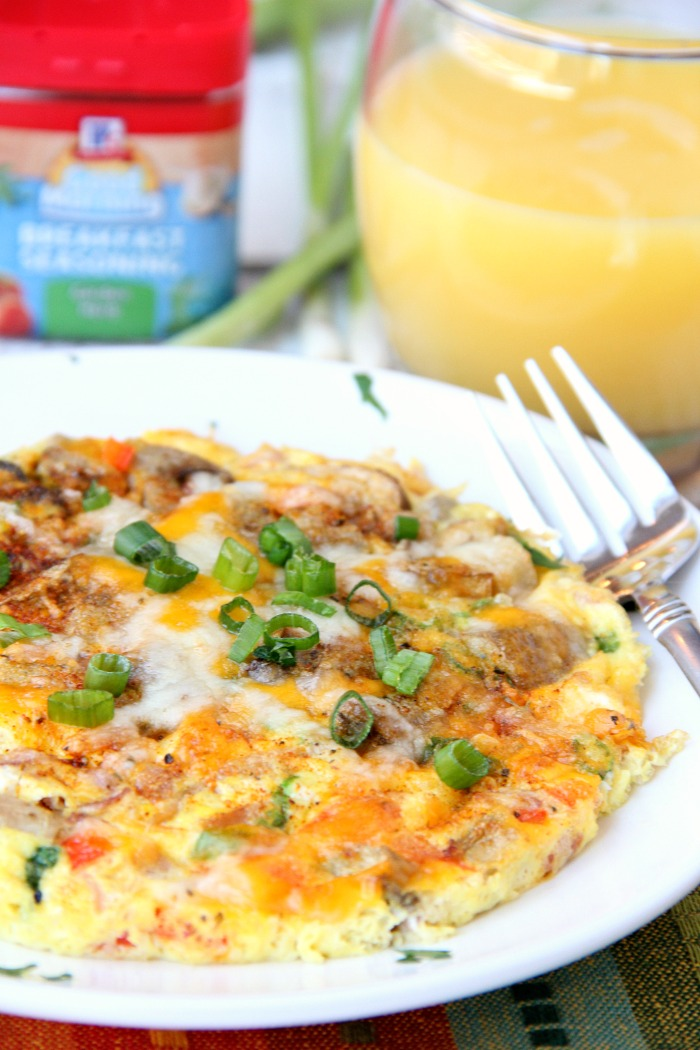 Easy Air Fryer Omelette - Prepared in the air fryer and filled with fresh veggies and cheese, this omelette is delicious and ready in 6 minutes!
