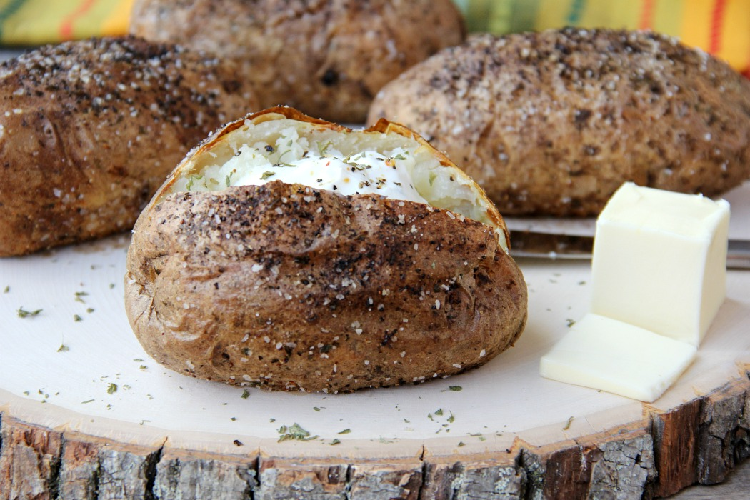Easy Air Fryer Baked Potatoes - Tender, delicious baked potatoes with a crispy, flavorful skin. You'll never go back to microwaving or baking in the oven again!