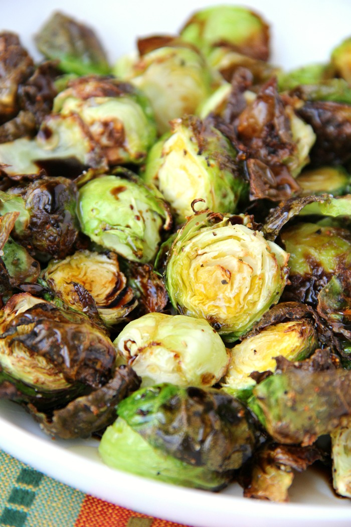 To prepare the brussels sprouts, you just want to wash them, cut off the end of the sprouts, slice them in half and take off some of their outer leaves.