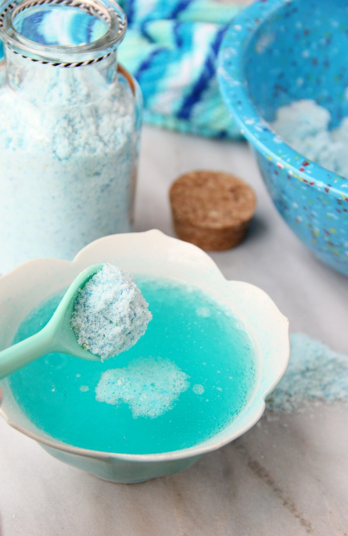 Fizzy Tropical Bath Powder - A light, airy, coconut scented powder that's calming, soothing and fizzes with pops of blue and green color when it hits the bath water, turning your water a beautiful turquoise blue.