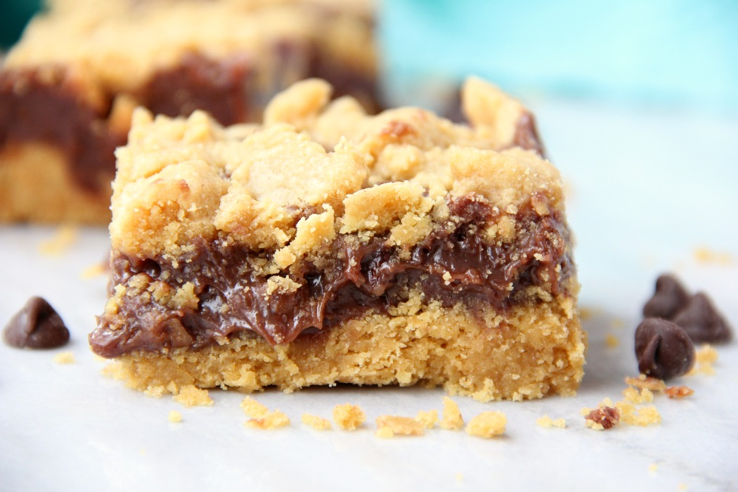 Fudge Crumble Bars - Fudge, peanut butter and coconut pecan frosting enveloped by a delicious yellow cake mix crust and crumble topping!