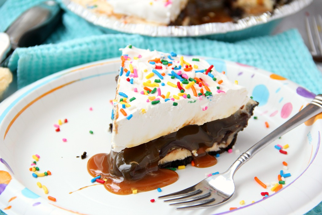 Ultimate Ice Cream Sundae Pie - Fudge and caramel topping filled ice cream pie with a fluffy whipped topping covered in sprinkles!