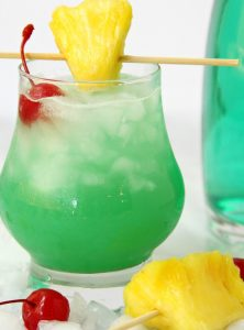Green Hawaiian Cocktail - a beautiful and refreshing combination of vodka, coconut rum, blue curacao, pineapple juice and lemon-lime soda. It's the perfect drink for summer!