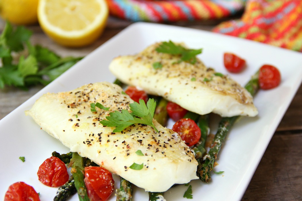 Sheet Pan Cod - A simple one-sheet recipe that features light, flaky cod alongside colorful asparagus and tomatoes. Lemon pepper, fresh lemon juice and grated Parmesan cheese top off the dish.