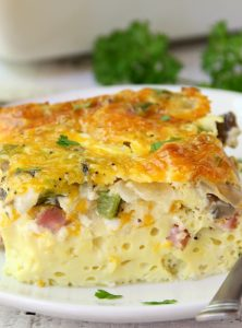 Ultimate Oven Omelette - This omelette is filled with veggies, ham and cheese and baked in the oven. Perfect for a party crowd!