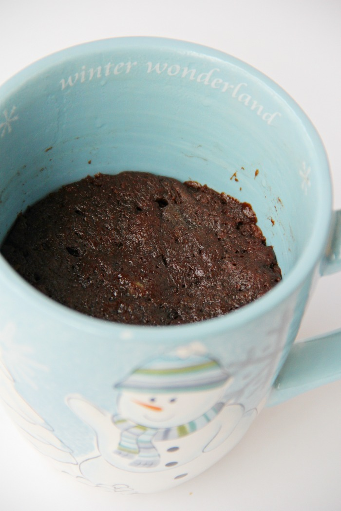Ultimate Brownie in a Mug - This decadent, five-ingredient rich and fudgy brownie is made in the microwave and ready to enjoy in minutes!