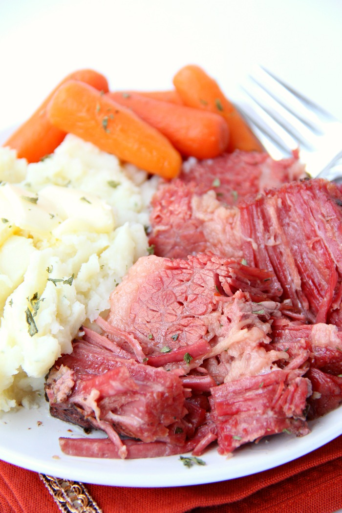 Instant Pot Corned Beef - Deliciously tender, juicy and flavorful corned beef and baby carrots made in your Instant Pot or Ninja Foodi in under two hours!