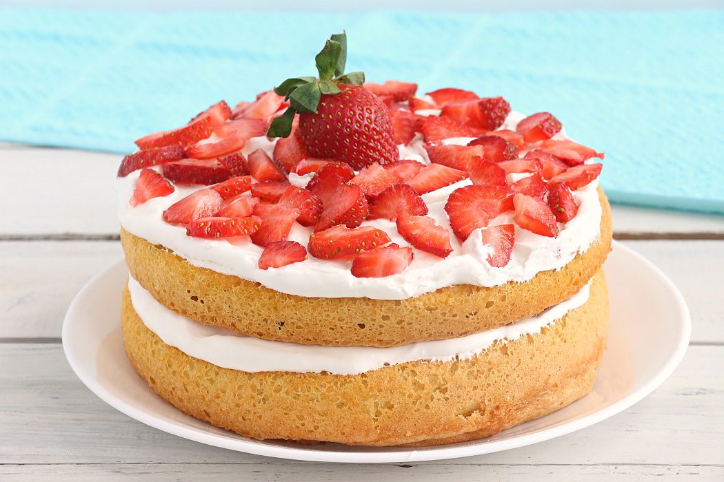 Air Fryer Angel Food Cake - A simple and beautiful layered cake topped with strawberries and cream, made right in the air fryer!