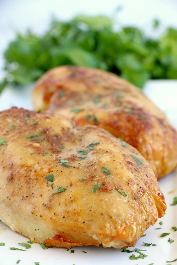 Air Fryer Chicken Breasts - Juicy and flavorful chicken breasts made right in the air fryer! Eat them on their own or add to salads, casseroles or other dishes!