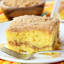 Easy Coffee Cake - A delicious and easy coffee cake made with a doctored-up yellow cake mix and filled and topped with crumbly, buttery cinnamon streusel!