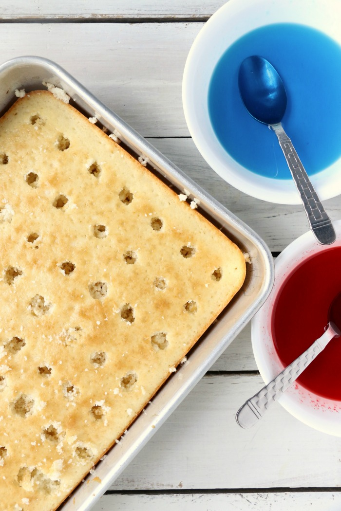 Red White and Blue Jello Poke Cake - A colorful and delicious cake, perfect for Memorial Day, the 4th of July or any patriotic celebration! The Jello is what makes it super moist!