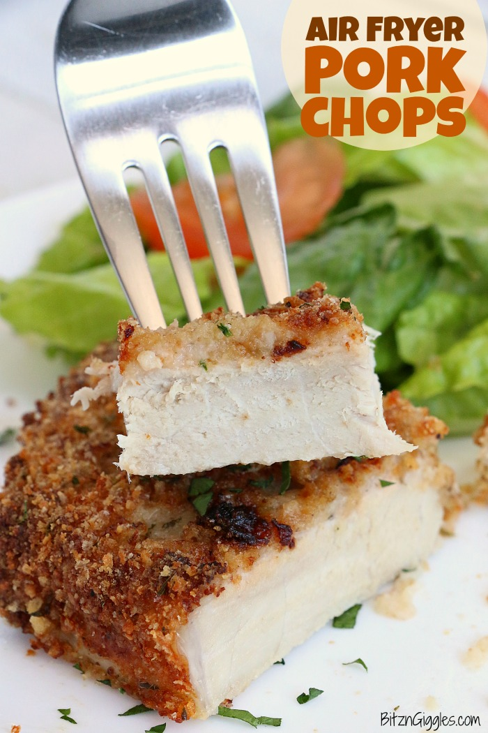 Air Fryer Pork Chops - Pork chops dredged in ranch dressing, coated in a parmesan cheese breadcrumb mixture and air fried to perfection. Tender on the inside and crispy on the outside!
