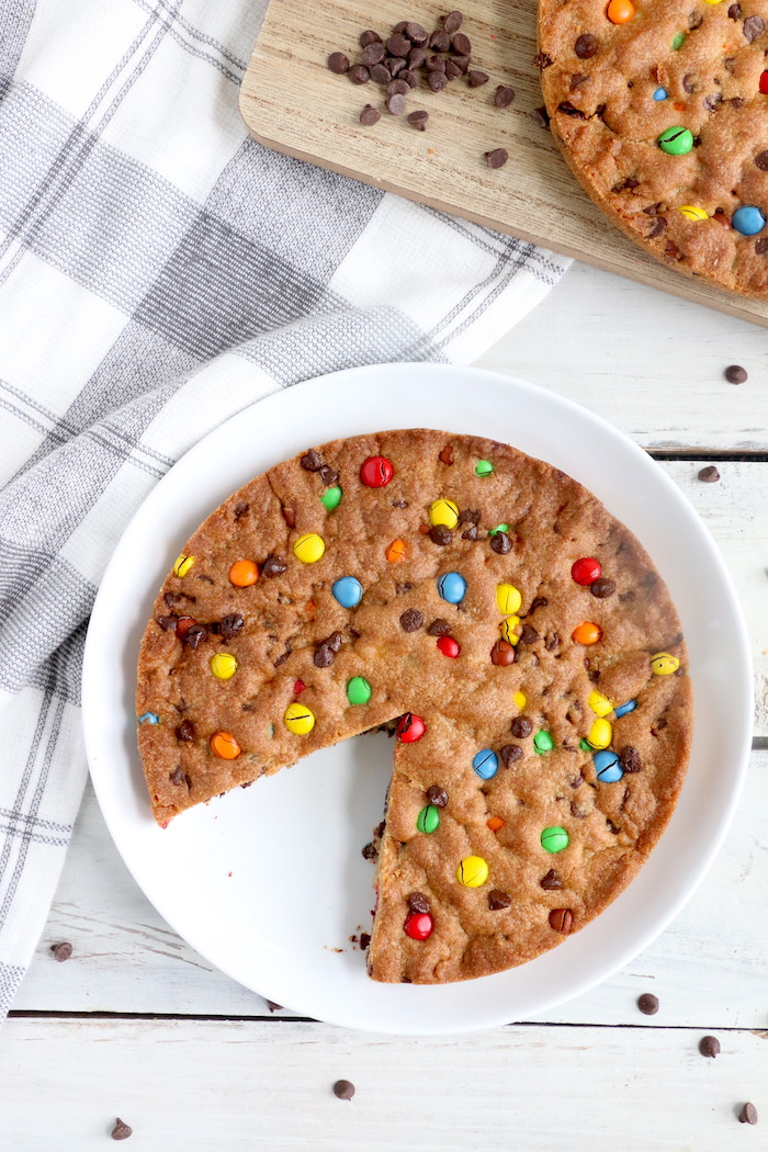 Air Fryer Pizookie - A soft and chewy cookie filled with mini chocolate chips and M&Ms made right in the air fryer in under 10 minutes! Large enough to serve a crowd!