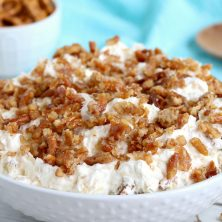 Pineapple Pretzel Salad - This cool, creamy pineapple fluff filled with candied pretzels is the perfect combination of sweet and salty, and can be served as a dessert or sweet side dish!