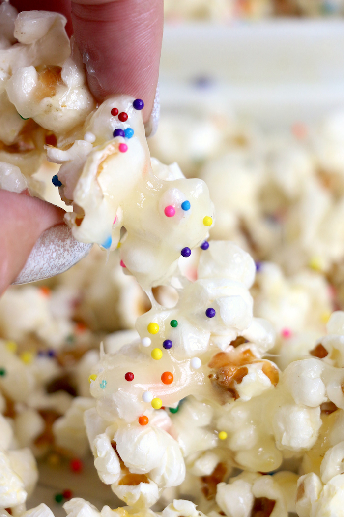 Sticky Popcorn - Five-ingredient vanilla caramel corn that's sweet, sticky and completely addicting!