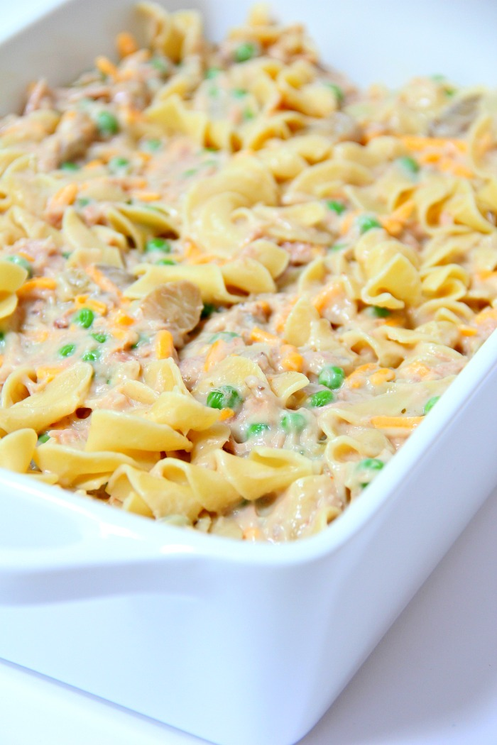 Classic Tuna Noodle Casserole - Ready in under 45 minutes, this classic and comforting casserole features tuna, onions, mushrooms, peas and cheese in a creamy sauce topped with more cheese and crunchy French fried onions! So flavorful, and sure to satisfy the entire family!