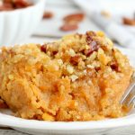 Easy Sweet Potato Casserole - An easy and delicious casserole that comes together with no scrubbing, boiling or baking the sweet potatoes! Topped with a sweet, salty and crunchy streusel, your guests will devour this simple and tasty side dish!