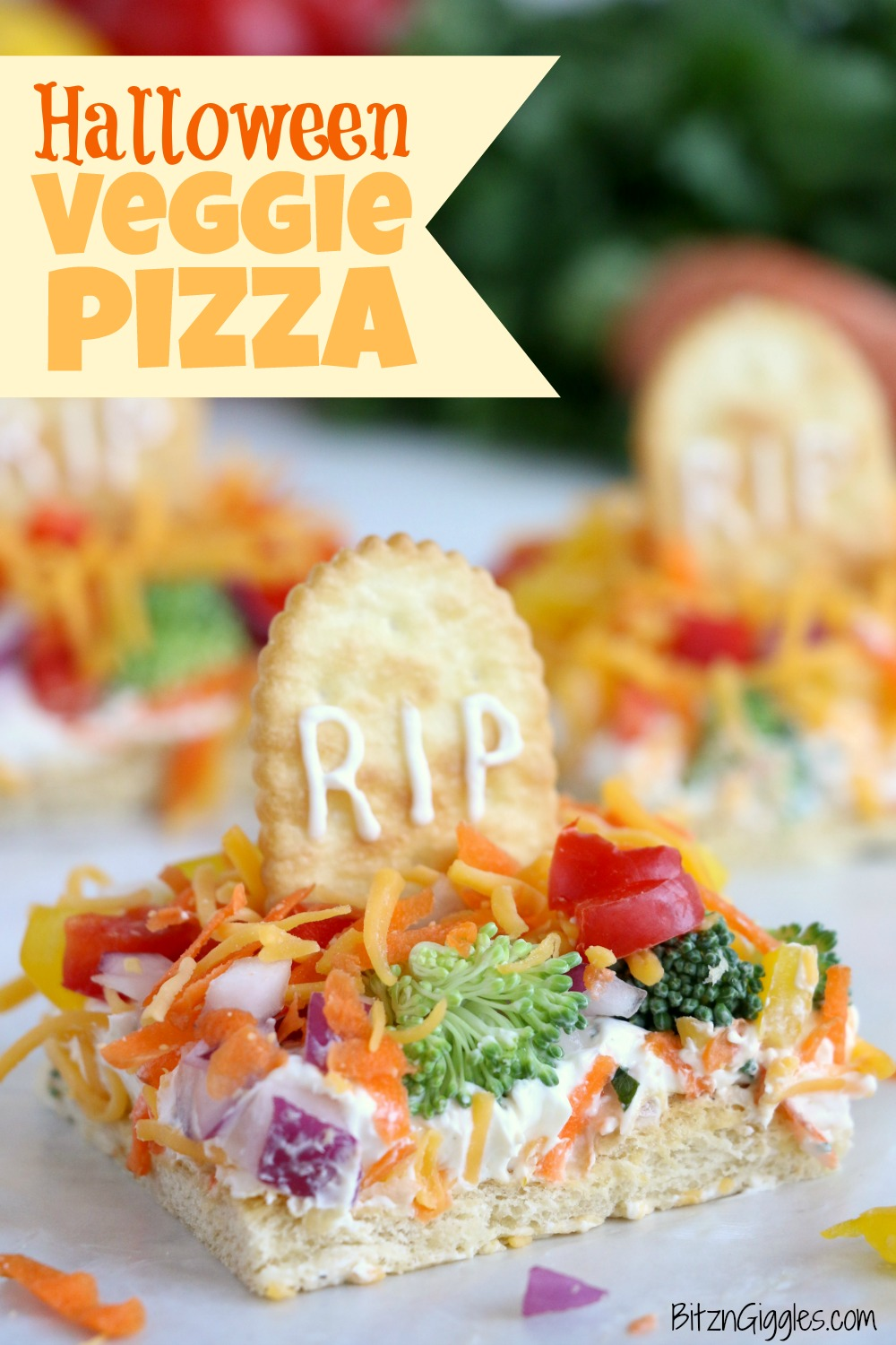 "Halloween Veggie Pizza - A spooky themed graveyard pizza featuring a flavorful ranch cream cheese covered crust, topped with colorful veggies and ""tombstone"" crackers."