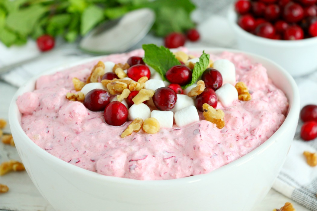 Cranberry Fluff - Tangy, chilled cranberries and sweet crushed pineapple, folded into marshmallow-filled whipped cream makes this side dish a family favorite!