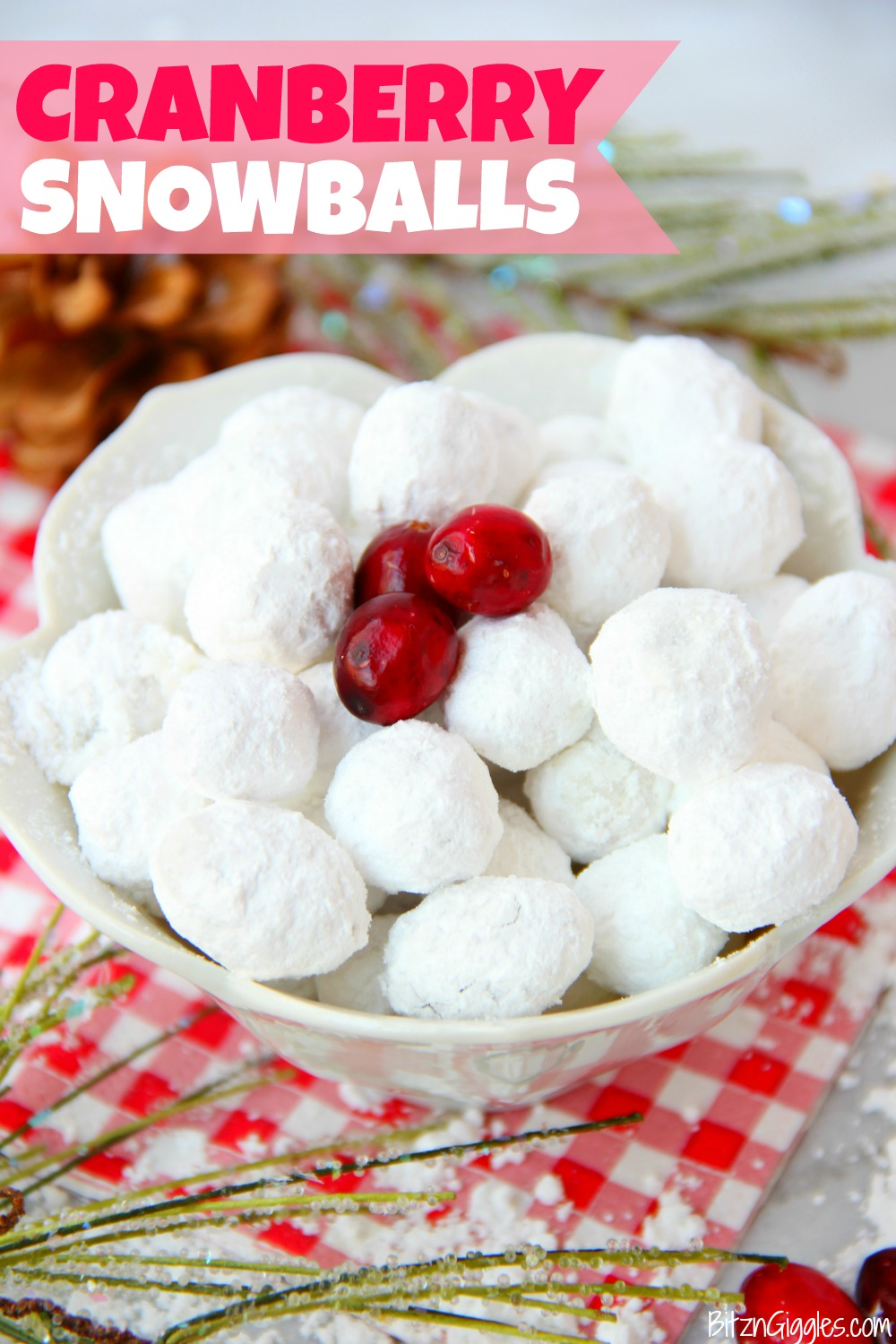 Cranberry Snowballs -Fresh cranberries rolled in powdered sugar then baked and chilled. Surprise your guests with a burst of delicious cranberry when they bite into these sweet and tangy confections!