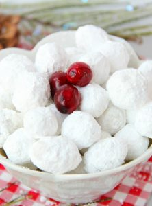 Cranberry Snowballs - Fresh cranberries rolled in powdered sugar then baked and chilled. Surprise your guests with a burst of delicious cranberry when they bite into these sweet and tangy confections!