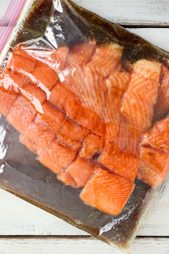 salmon and marinade in plastic storage bag