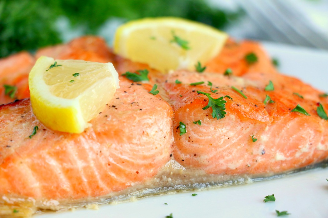 salmon up close with lemon slices