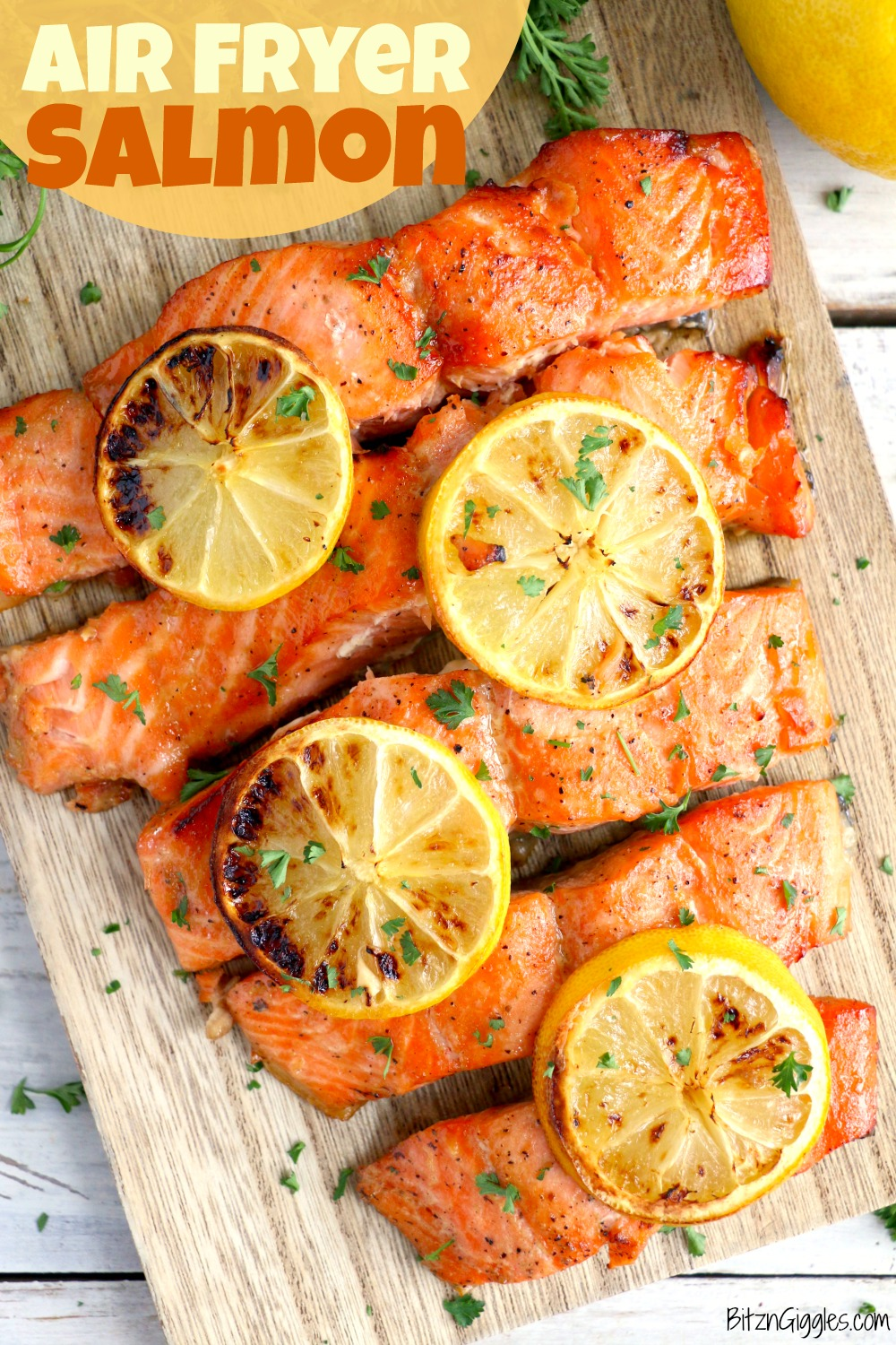 Salmon on a cutting board with lemon slices