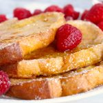French toast with maple syrup and raspberries
